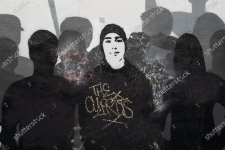 A photo of Joaquin Oliver. One of 17 people murdered in the Parkland shooting. The Mural artists tag is seen on the photo. A powerful mural of people, who have impacted peoples lives in and out of the U.S. is seen on a street in Wynwood, the art district of Miami. CDC Shutters Dining and Bars, saying it's risky due to the spread of COVID-19.