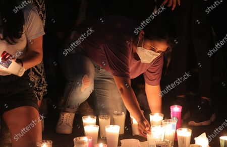 Stock Photo of Family and friends of murdered teacher Jessica Gonzalez Villasenor light candles outside the Government Palace in Morelia, Michoacan, Mexico, 25 September 2020. People protested to call for the investigation to be expedited.