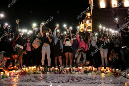 Family and friends of murdered teacher Jessica Gonzalez Villasenor hold candles outside the Government Palace in Morelia, Michoacan, Mexico, 25 September 2020. People protested to call for the investigation to be expedited.