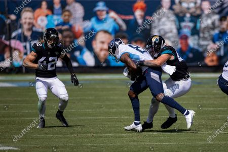Jacksonville Jaguars middle linebacker Joe Schobert (47) tackles Tennessee Titans wide receiver Corey Davis (84) during an NFL football game, in Nashville, Tenn