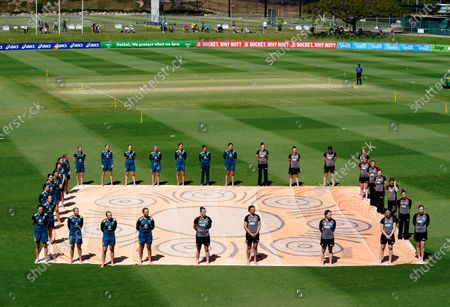 Players stand in solidarity for 'Close The Gap' in awareness to the gap between Indigenous and non-indigenous Australians prior to the T20 International match between Australia Women and New Zealand at Allan Border Field in Brisbane, Australia, 26 September 2020.