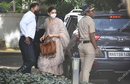 Bollywood actor, Deepika Padukone, center, arrives at the office of narcotics control board, in Mumbai, India, . Bollywood star, Deepika Padukone, was questioned on Saturday by India's narcotics control board which is probing the movie industry's links with drug peddler and cartels, officials said