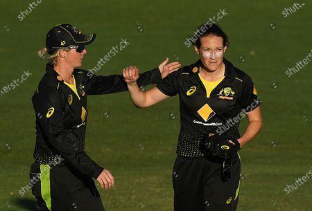 Australian bowler Megan Schutt (R) is congratulated following a wicket during the T20 International match between Australia Women and New Zealand Women at Allan Border Field in Brisbane, Australia, 26 September 2020.