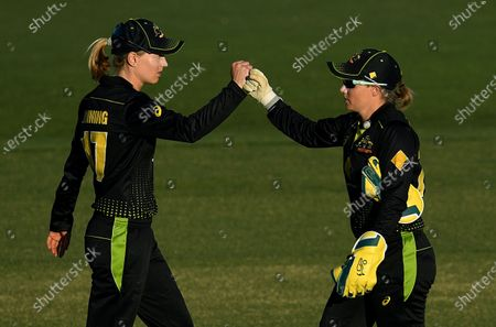 Stock Photo of Australians Meg Lanning (L) and Alyssa Healy celebrate following a wicket during the T20 International match between Australia Women and New Zealand Women at Allan Border Field in Brisbane, Australia, 26 September 2020.