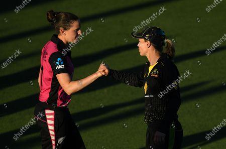 Australian captain Meg Lanning reacts with New Zealand player Amy Satterthwaite following the T20 International match between Australia Women and New Zealand Women at Allan Border Field in Brisbane, Australia, 26 September 2020.