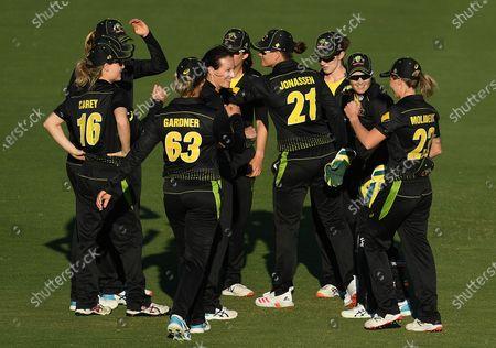 Australian players celebrate together following the T20 International match between Australia Women and New Zealand Women at Allan Border Field in Brisbane, Australia, 26 September 2020.