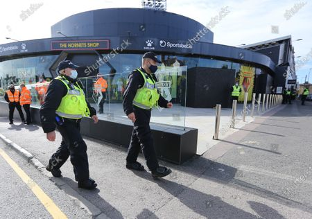 Police patrol seen near Graham Taylor statue which is boarded up ahead of the Watford v Luton football match