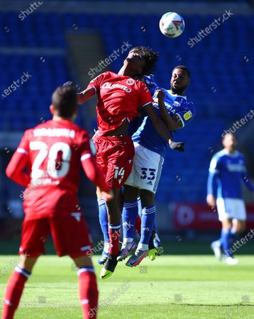 Ovie Ejaria of Reading and Junior Hoilett of Cardiff City challenge for a header; Cardiff City Stadium, Cardiff, Glamorgan, Wales; English Football League Championship Football, Cardiff City versus Reading.
