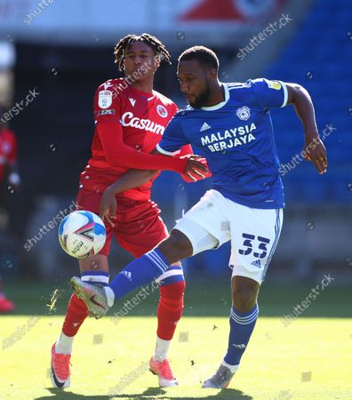 Junior Hoilett of Cardiff City controls the ball as he is pressured by Michael Olise of Reading; Cardiff City Stadium, Cardiff, Glamorgan, Wales; English Football League Championship Football, Cardiff City versus Reading.