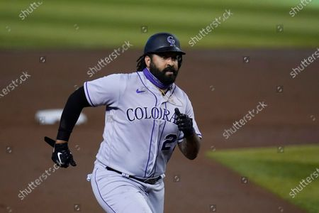 Stock Picture of Colorado Rockies' Matt Kemp runs to third base in the second inning during the first game of a baseball doubleheader against the Arizona Diamondbacks, in Phoenix