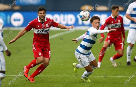Luke Amos of QPR & Sam Morsy of Middlesbrough compete for a lose ball