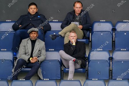 QPR director Les Ferdinand watches the action from the director's box