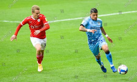 Gustavo Hamer of Coventry City chased by Luke Thomas of Barnsley
