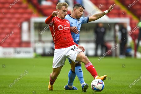 Luke Thomas of Barnsley and  Gustavo Hamer of Coventry City