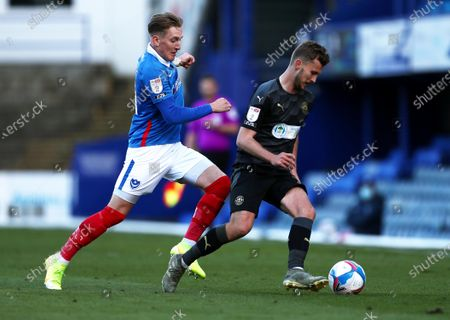 Ronan Curtis of Portsmouth and Tom James of Wigan Athletic.