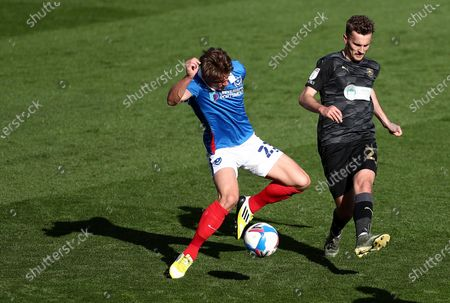 Cameron Pring of Portsmouth and Tom James of Wigan Athletic.