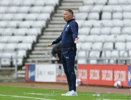Darren Ferguson manager of Peterborough United appeals for a decision from the referee