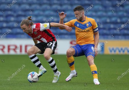 Stock Picture of Exeter City's Matt Jay holds off Mansfield Town's Ollie Clarke