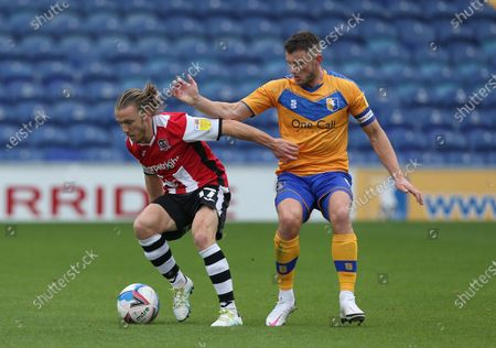 Stock Image of Exeter City's Matt Jay battles with Mansfield Town's ollie Clarke