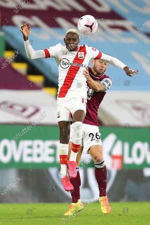 Southampton's Moussa Djenepo and Phil Bardsley of Burnley