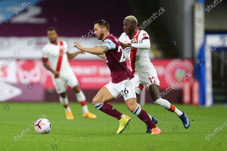 Phil Bardsley of Burnley and Southampton's Moussa Djenepo