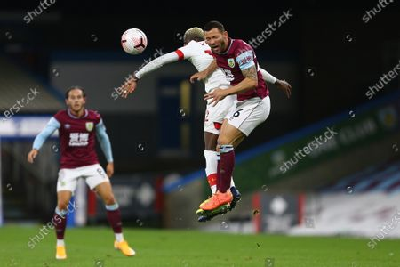 Phil Bardsley of Burnley receives an elbow to the head