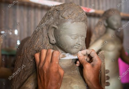 A Bangladeshi artist works on an idol of the Goddess Durga ahead of the largest Durga Puja festival of the Bengali Hindus community in Dhaka, Bangladesh, 26 September 2020. The Durga puja will run from 22 to 26 October. According to Hindu faith, goddess Durga comes down to the earth from the heaven to establish peace, harmony by annihilating evil forces.
