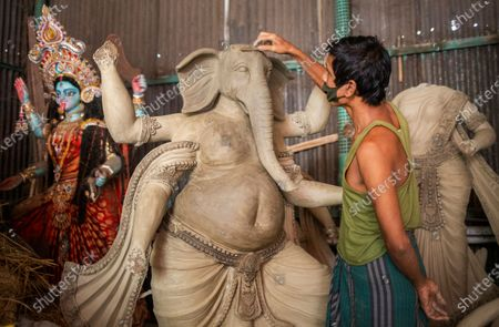 A Bangladeshi artist works on an idol of the God Ganesha ahead of the largest Durga Puja festival of the Bengali Hindus community in Dhaka, Bangladesh, 26 September 2020. The Durga puja will run from 22 to 26 October. According to Hindu faith, goddess Durga comes down to the earth from the heaven to establish peace, harmony by annihilating evil forces.