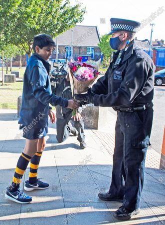 A young rugby player with flowers for Sgt Matt Ratana at Croydon Custody Centre this morning. A murder investigation has been launched by police after the death of custody police sergeant Matt Ratana at the Croydon Custody Centre in South London yesterday.Photo credit:Grant Falvey/LNP