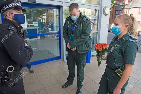 Paramedics with flowers for Sgt Matt Ratana at Croydon Custody Centre. A murder investigation has been launched by police after the death of custody police sergeant Matt Ratana at the Croydon Custody Centre in South London yesterday.Photo credit:Grant Falvey/LNP