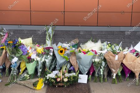 A flower memorial for Sgt Matt Ratana at Croydon Custody Centre. A murder investigation has been launched by police after the death of custody police sergeant Matt Ratana at the Croydon Custody Centre in South London yesterday.Photo credit:Grant Falvey/LNP