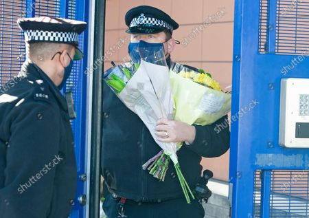 Flowers for Sgt Matt Ratana at Croydon Custody Centre this morning. A murder investigation has been launched by police after the death of custody police sergeant Matt Ratana at the Croydon Custody Centre in South London yesterday.Photo credit:Grant Falvey/LNP