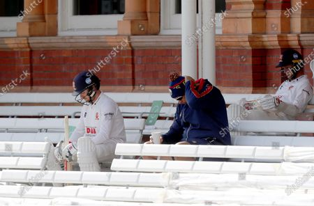 Adam Wheater (left) and Jamie Porter of Essex sit and wait for the bell during Somerset CCC vs Essex CCC, Bob Willis Trophy Final Cricket at Lord's Cricket Ground on 26th September 2020