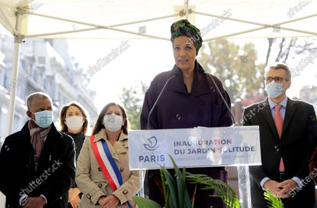 Stock Image of French actress Marie-Noelle Eusebe delivers her speech during the inauguration of a park honoring 'Solitude', a woman who fought for the liberation of slaves on the Caribbean island of Guadeloupe, in Paris, . Paris Mayor Anne Hidalgo, second left, plans to erect a statue in honour of Solitude at the site, the city's first statue honoring a Black woman. Amid global protests against monuments to white men linked to colonialism or the slave trade, French leaders have pushed instead to erect new monuments to more diverse, lesser-known historical figures