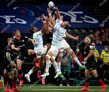 Stock Photo of Racing 92 vs Saracens. Saracens' Sean Maitland competes against Teddy Thomas and Antonie Claassen of Racing 92 in the air