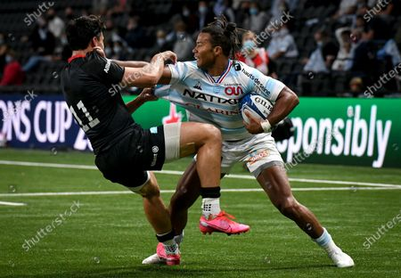Racing 92 vs Saracens. Racing's Teddy Thomas comes up against Sean Maitland of Saracens