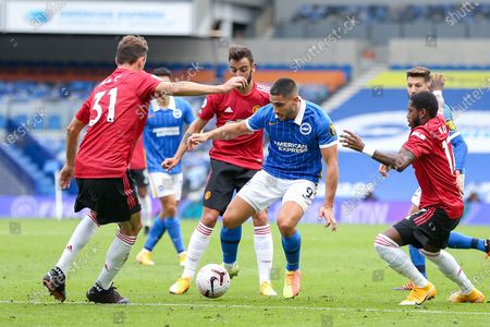 Stock Picture of Brighton and Hove Albion forward Neal Maupay (9) battles with Manchester United Midfielder Nemanja Matic and Manchester United Midfielder Fred during the Premier League match between Brighton and Hove Albion and Manchester United at the American Express Community Stadium, Brighton and Hove