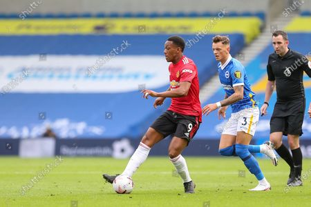 Stock Image of Manchester United Forward Anthony Martial battles with Brighton and Hove Albion defender Ben White (3) during the Premier League match between Brighton and Hove Albion and Manchester United at the American Express Community Stadium, Brighton and Hove