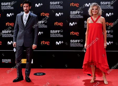 Stock Image of Edurne Ormazabal (R) and Argentinian actor Juan Diego Botto (L) pose for photographers at their arrival to the closing ceremony of the 68th annual San Sebastian International Film Festival (SSIFF), in San Sebastian, Spain, 26 September 2020. The film festival runs from 18 to 26 September 2020 under safety measures like obligatory face mask use and red carpets without public due to the Covid-19 coronavirus pandemic. Organizers have also reduced the number of film screenings as well as the seating capacity in cinemas.