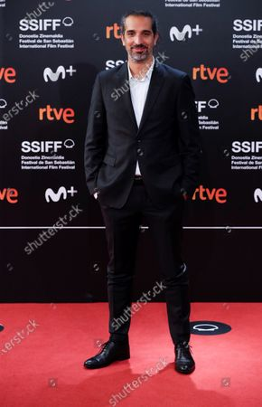 Javier Ruiz Caldera poses for photographers at his arrival to the closing ceremony of the 68th annual San Sebastian International Film Festival (SSIFF), in San Sebastian, Spain, 26 September 2020. The film festival runs from 18 to 26 September 2020 under safety measures like obligatory face mask use and red carpets without public due to the Covid-19 coronavirus pandemic. Organizers have also reduced the number of film screenings as well as the seating capacity in cinemas.