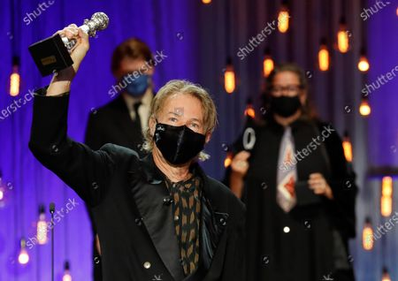Stock Picture of Julien Temple reacts after receiving the Special Jury Award during the closing ceremony of the 68th annual San Sebastian International Film Festival (SSIFF), in San Sebastian, Spain, 26 September 2020. The film festival runs from 18 to 26 September 2020 under safety measures like obligatory face mask use and red carpets without public due to the Covid-19 coronavirus pandemic. Organizers have also reduced the number of film screenings as well as the seating capacity in cinemas.