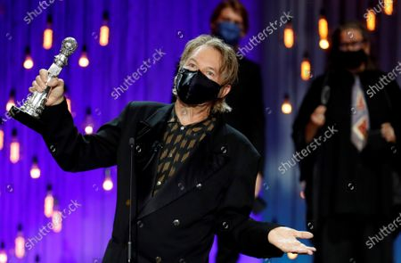 Stock Photo of Julien Temple reacts after receiving the Special Jury Award during the closing ceremony of the 68th annual San Sebastian International Film Festival (SSIFF), in San Sebastian, Spain, 26 September 2020. The film festival runs from 18 to 26 September 2020 under safety measures like obligatory face mask use and red carpets without public due to the Covid-19 coronavirus pandemic. Organizers have also reduced the number of film screenings as well as the seating capacity in cinemas.