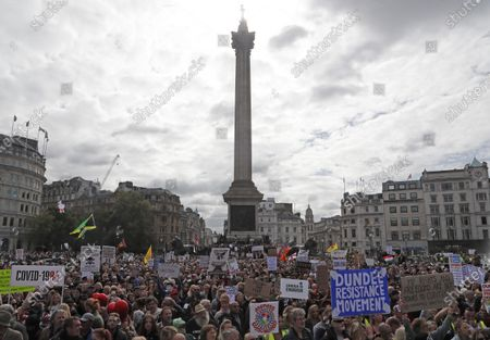 People take part in a 'We Do Not Consent' rally at Trafalgar Square, organised by Stop New Normal, to protest against coronavirus restrictions, in London