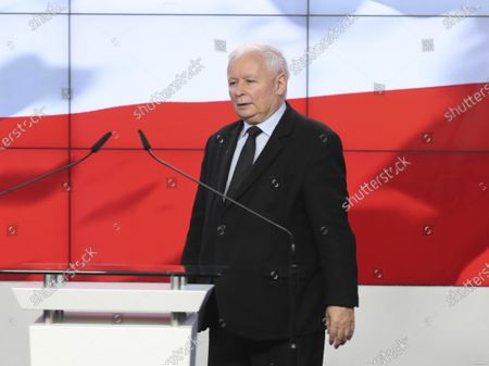 The leader of the Polish ruling party, Jaroslaw Kaczynski,center, speaks to reporters in Warsaw, Poland, . The three parties in Poland's conservative coalition government signed a new coalition agreement on Saturday, putting aside disagreements. But they gave no details, leaving lingering uncertainty about how the Cabinet will look in practice after an expected reshuffle