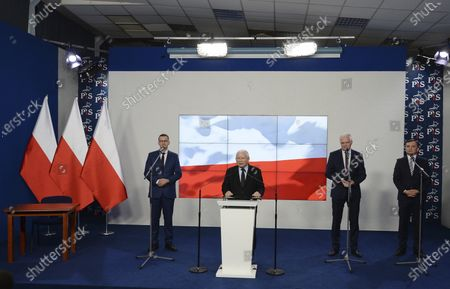 Stock Image of The leader of the Polish ruling party, Jaroslaw Kaczynski,center, speaks to reporters alongside Prime Minister Mateusz Morawiecki,left, and the leaders of two junior coalition partners, Jaroslw Gowin and Zbigniew Ziobro,right, in Warsaw, Poland, . The three parties in Poland's conservative coalition government signed a new coalition agreement on Saturday, putting aside disagreements. But they gave no details, leaving lingering uncertainty about how the Cabinet will look in practice after an expected reshuffle