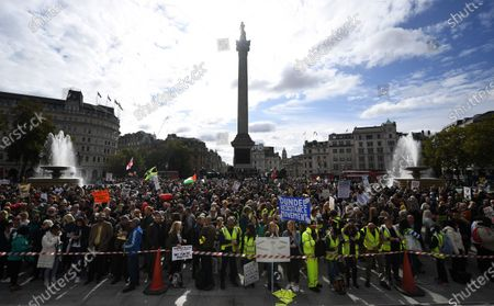 People attend a 'We Do Not Consent' rally at Trafalgar Square in London, Britain, 26 September 2020. Thousends of people gathered at a demonstration to protest against new coronavirus restrictions.