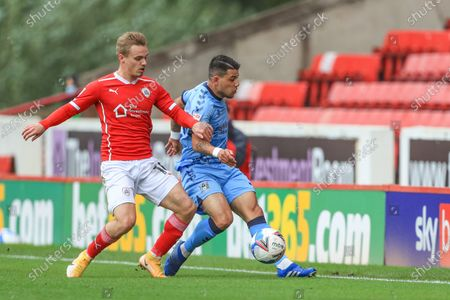 Gustavo Hamer (38) of Coventry City clears the ball as Luke Thomas (16) of Barnsley pressures