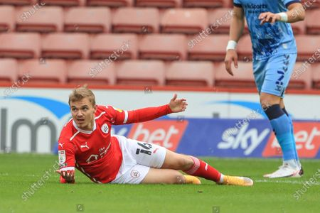 Luke Thomas (16) of Barnsley appeals to referee Jeremy Simpson as he's fouled