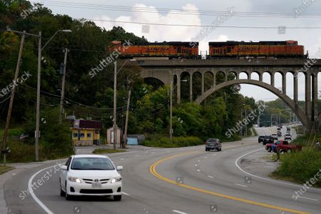Stock Photo of Cars travel under a landmark railroad viaduct on a stretch of Blue Parkway, in Kansas City, Mo. The stretch of road, along with parts of two other streets, would be renamed to honor Rev. Martin Luther King Jr. under a city proposal coming in the wake of failed effort to honor King last year