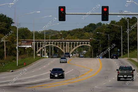 Cars travel under a landmark railroad viaduct on a stretch of Blue Parkway, in Kansas City, Mo. The stretch of road, along with parts of two other streets, would be renamed to honor Rev. Martin Luther King Jr. under a city proposal coming in the wake of failed effort to honor King last year